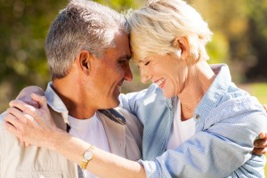 loving middle aged couple hugging with eyes closed closeup portr